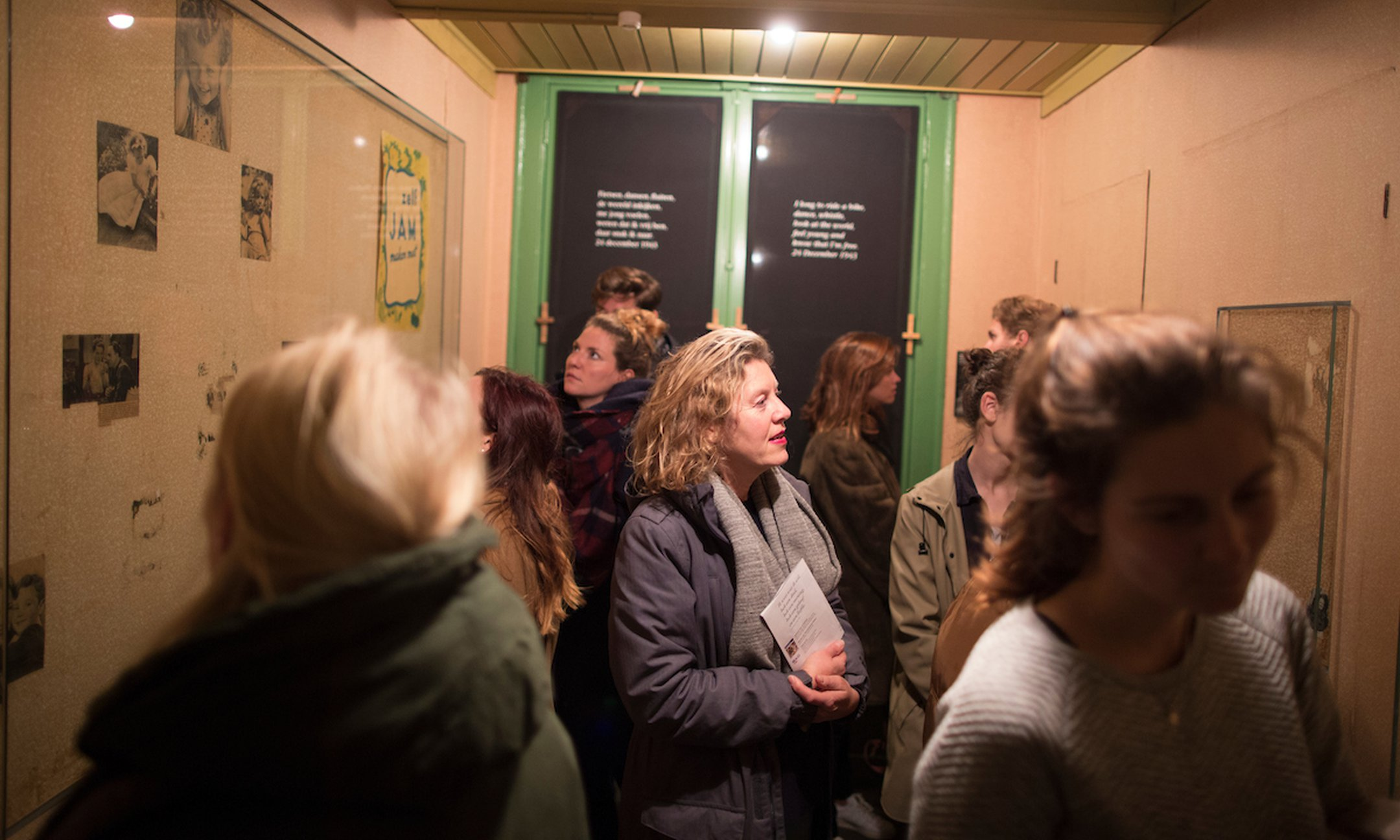 Visitors inside Anne Frank's room in the Secret Annex