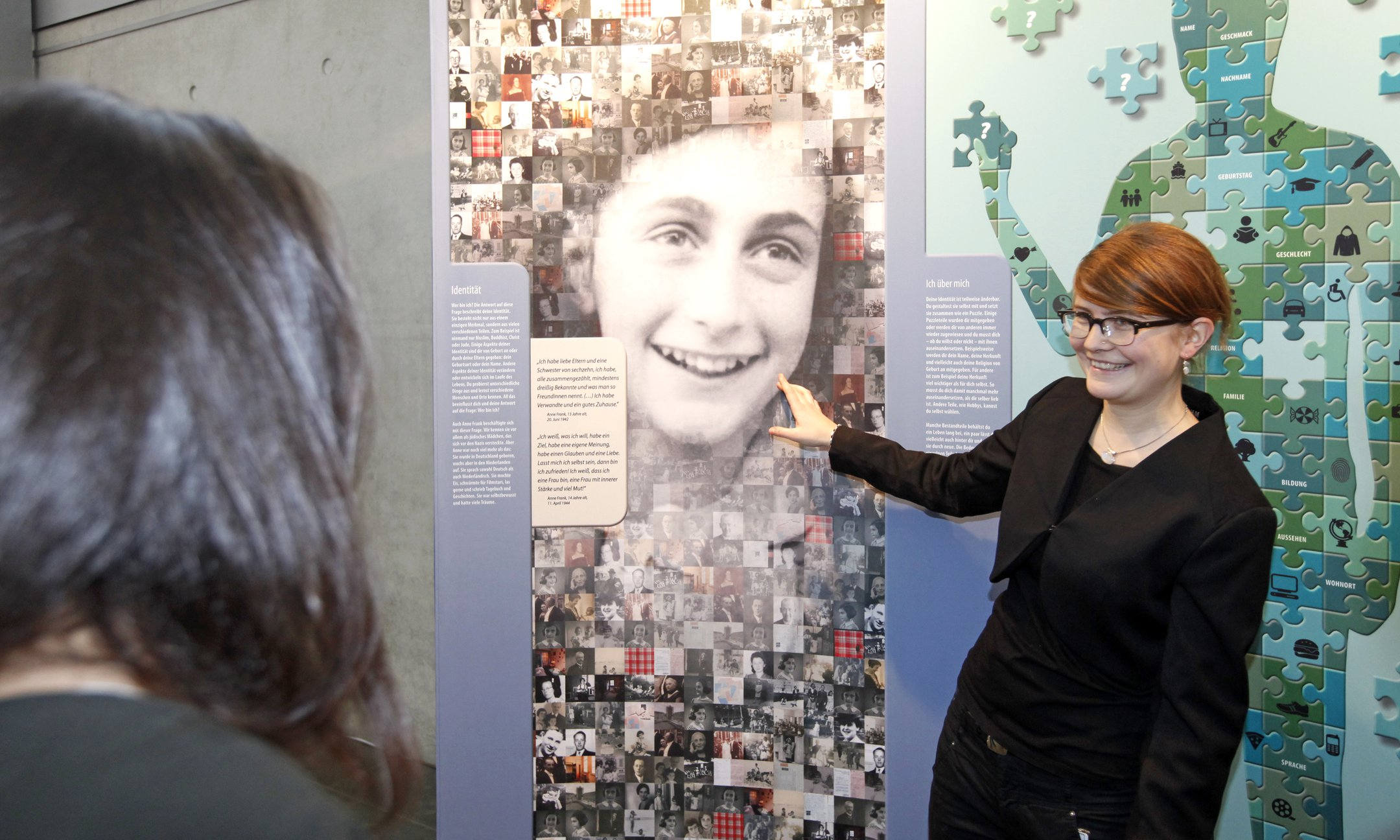 A peer guide in action at an Anne Frank exhibition in Berlin, Germany